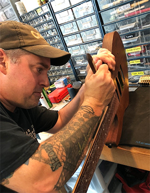 Jake repairing a guitar